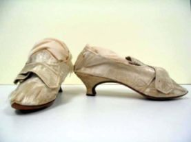 "White, pointed high heels, ""straight"" design, ca. 1760; worn by Mrs. Wilson Blount (signed on soles)."