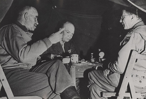 """General Wyche (right) lunches with Gens. Bradley and Eisenhower in Normandy, less than a month after the Allied invasion"". 1944. Image courtesy of ECU Libraries."