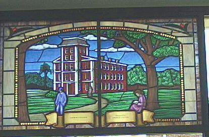 """Stained glass window depicting the surviving Yadkin College building. (Window is at the West Davidson Public Library, Tyro)."" Image courtesy of State Archives of North Carolina."